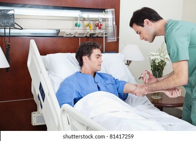 Doctor giving injection to the young patient in hospital