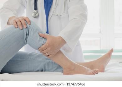 Doctor giving a patient a leg treatment