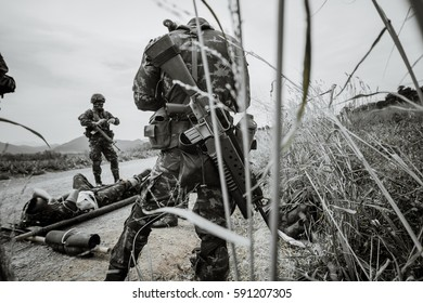 The doctor is giving water to a wounded soldier  ,  United States Army ranger medic treating the wounds of his injured fellow in arms in the mountains