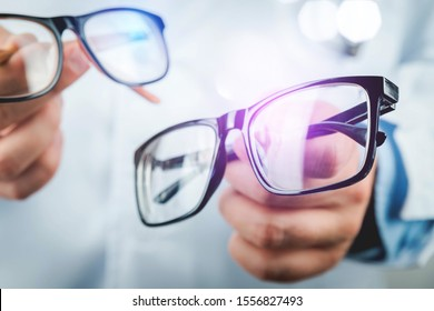 Doctor with glasses in hand