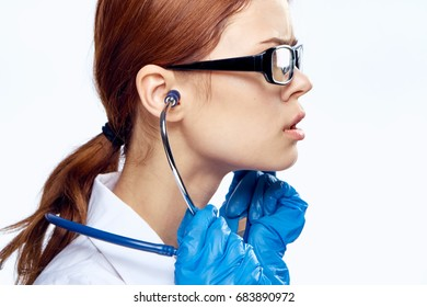 Doctor with glasses with stethoscope in profile