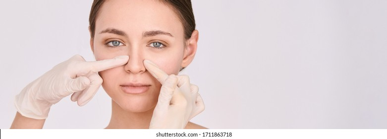 Doctor glover near patient nose. Dermatologist hands. Rhinoplasty analysis. Cosmetology girl consultation. Horizontal banner. Copyspace. Place for text. Symmetry face check