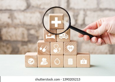 Doctor hand arranging wood block stacking with icon search healthcare medical, insurance for your health concept.