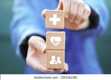 Doctor hand arranging wood block stacking with icon healthcare medical, insurance for your health concept.