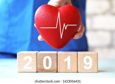 Doctor hand arranging wood block stacking with icon 2019 year healthcare medical, insurance for your health.