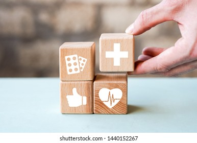 Doctor hand arranging wood block stacking with healthcare and medical icon, insurance for your health.