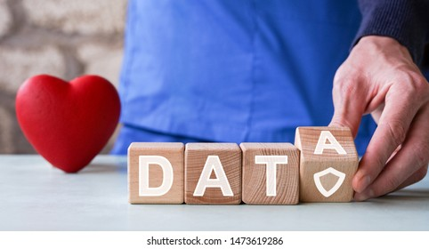 Doctor hand arranging wood block stacking with icon data in healthcare, insurance and protection for your health.