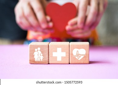 Doctor hand arranging wood block stacking with healthcare, medical icon, insurance for your health.