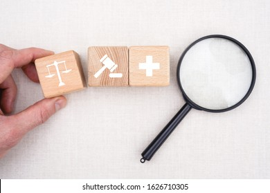 Doctor hand arranging wood block stacking with icon justice healthcare Labor Law Lawyer Legal search Concept medical.