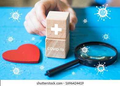Doctor hand arranging wood block stacking with covid-19 virus, coronavirus health care, insurance for your health