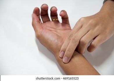 Doctor hand check on wrist pulse