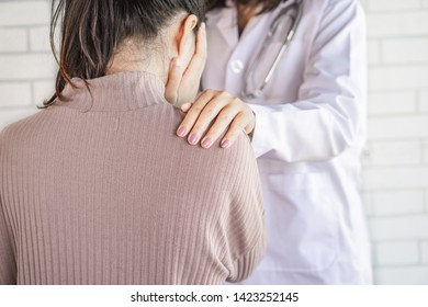 doctor hand comforting stress female patient at a hospital