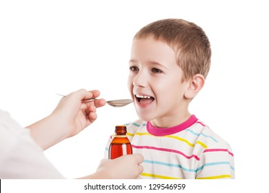 Doctor hand giving spoon dose of medicine liquid drinking syrup to child boy patient