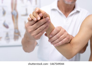 Doctor hand Physicist physical therapy treatment patient in the clinic.Orthopedic medical exam in doctor's hospital office Partnership, traumatology and medical consultation for hand wrist injury