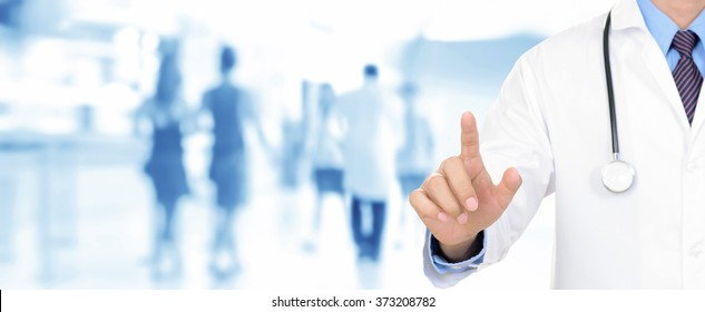 Doctor hand pointing on empty space (or virtual screen), medical panoramic background concept