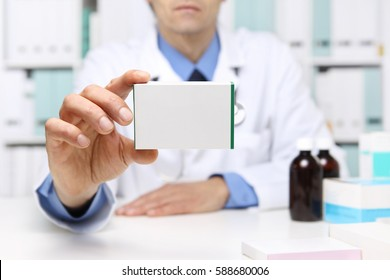 Doctor hand showing drug boxes at Office Desktop. Health care, Medical and Pharmacy Concept.
