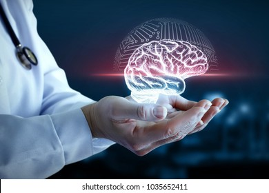 Doctor hand shows the scanning of the brain on a blue background.