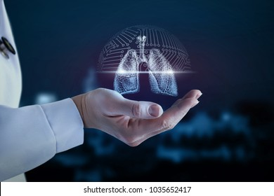 Doctor in the hand shows the scanning of the lung of the person.