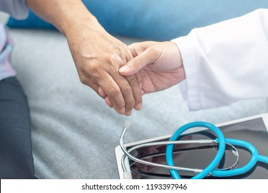 Doctor hand with stethoscope check up elderly woman people. Old aging female seeing medical physician in clinical healthcare hospital.