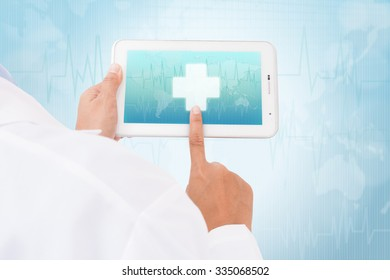 Doctor hand touch screen First Aid symbol on a tablet. medical icon
