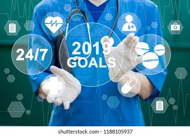 Doctor hand touching button 2019 goals healthcare in network on internet panel medicine.
