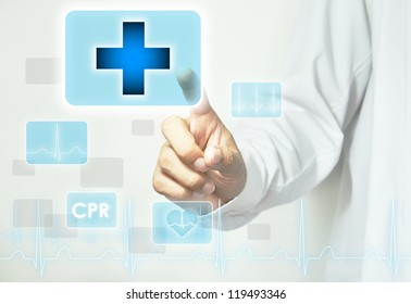 Doctor hand touching first aid sign on virtual screen - abstract medical background