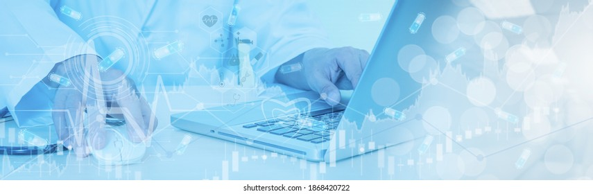 Doctor hand working with laptop computer,concept online marketing business of medical,healthcare,insurance with stock graph and diagram,medical examination analysis report,banner panoramic header