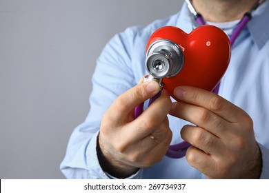 Doctor  hands with heart a listening medical stethoscope