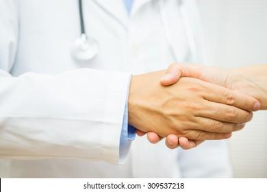 Doctor is handshaking with patient