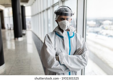 Doctor in hazmat suit and goggles in covid-19 pandemic. Hospital medical staff in protective wear, face shield and mask.