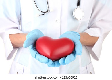 Doctor with heart in hand. isolated on white