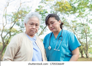 Doctor help and care Asian senior or elderly old lady woman with strong health while walking at park in happy fresh holiday.