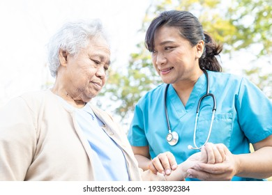 Doctor help and care Asian senior or elderly old lady woman walking at park in happy fresh holiday.