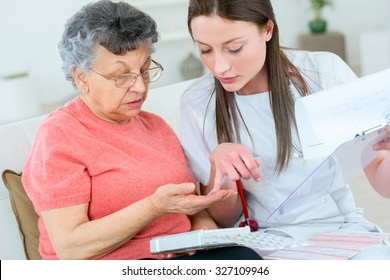Doctor helping patient with medication