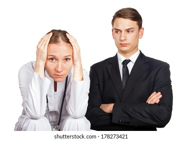 Doctor and her lawyer at a meeting for malpractice