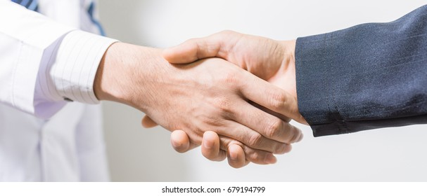 doctor and her lawyer shaking hands. panoramic banner