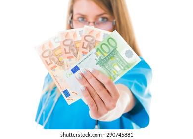 Doctor with her money in blue coat.