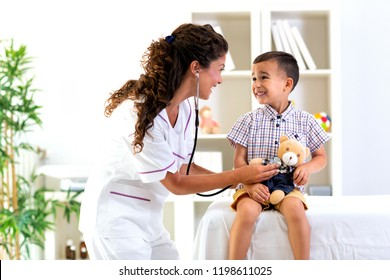 Doctor and her patient performing a stethoscope examination on patients teddy bear