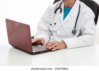 Doctor in his office working with a notebook