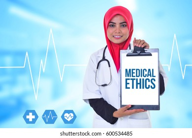 Doctor hold clipboard with text MEDICAL ETHICS