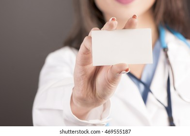 Doctor holding blank business card.