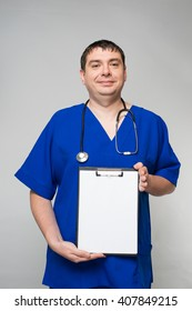 Doctor holding a blank form