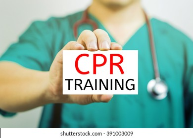 Doctor holding a  business card with capital lettering   CPR TRAINING in hand.Medical and healthcare  concept, medicals support and service, Selective focus.vintage tone.