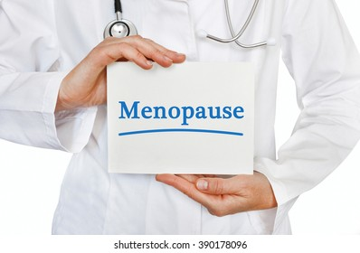 Doctor holding a card with Menopause, Medical concept