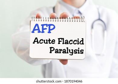 Doctor holding a card with text AFP Acute Flaccid Paralysis medical concept.