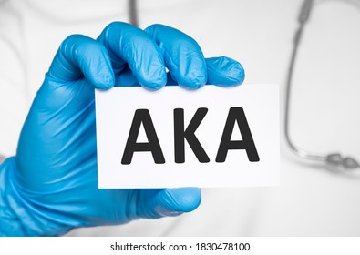 Doctor holding a card with text AKA Above the knee amputation., medical concept