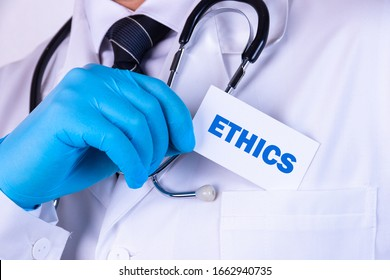 Doctor holding a card with text Ethics medical concept