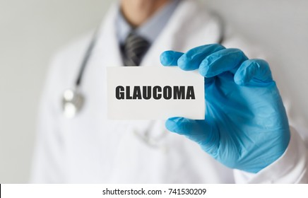 Doctor holding a card with text GLAUCOMA, medical concept