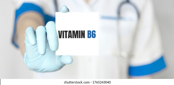 Doctor holding a card with text Vitamin B6,medical concept