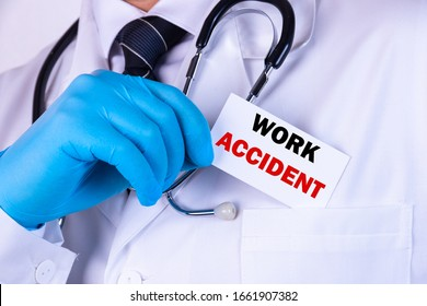 Doctor holding a card with text Work accident medical concept
